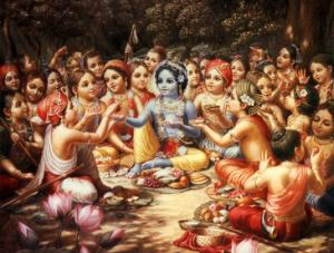 Lord Krishna enjoys prasadam with His friends